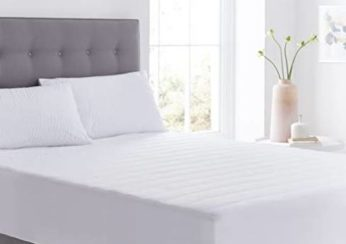 upholstered bed with white bedding
