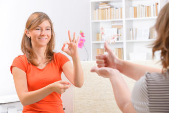 hearing impaired woman learning sign language