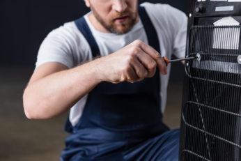 worker repairing water cooler