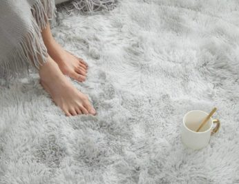 a pair of feet on a fluffy carpet