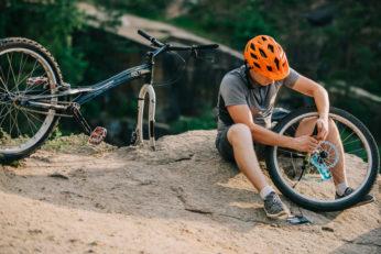 a young biker fixing a wheel
