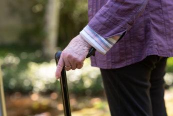 elderly holding cane