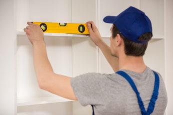 repair man installing shelves